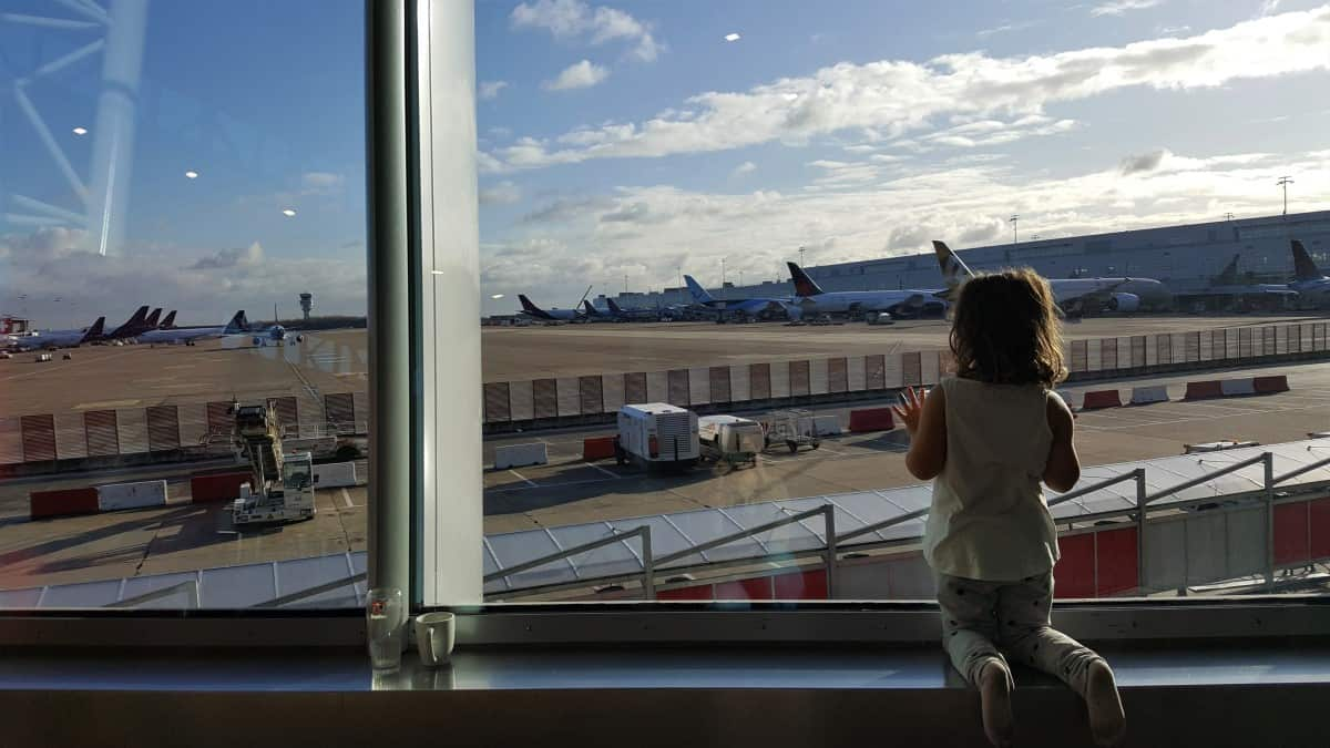 Little Elf watching the planes at the airport